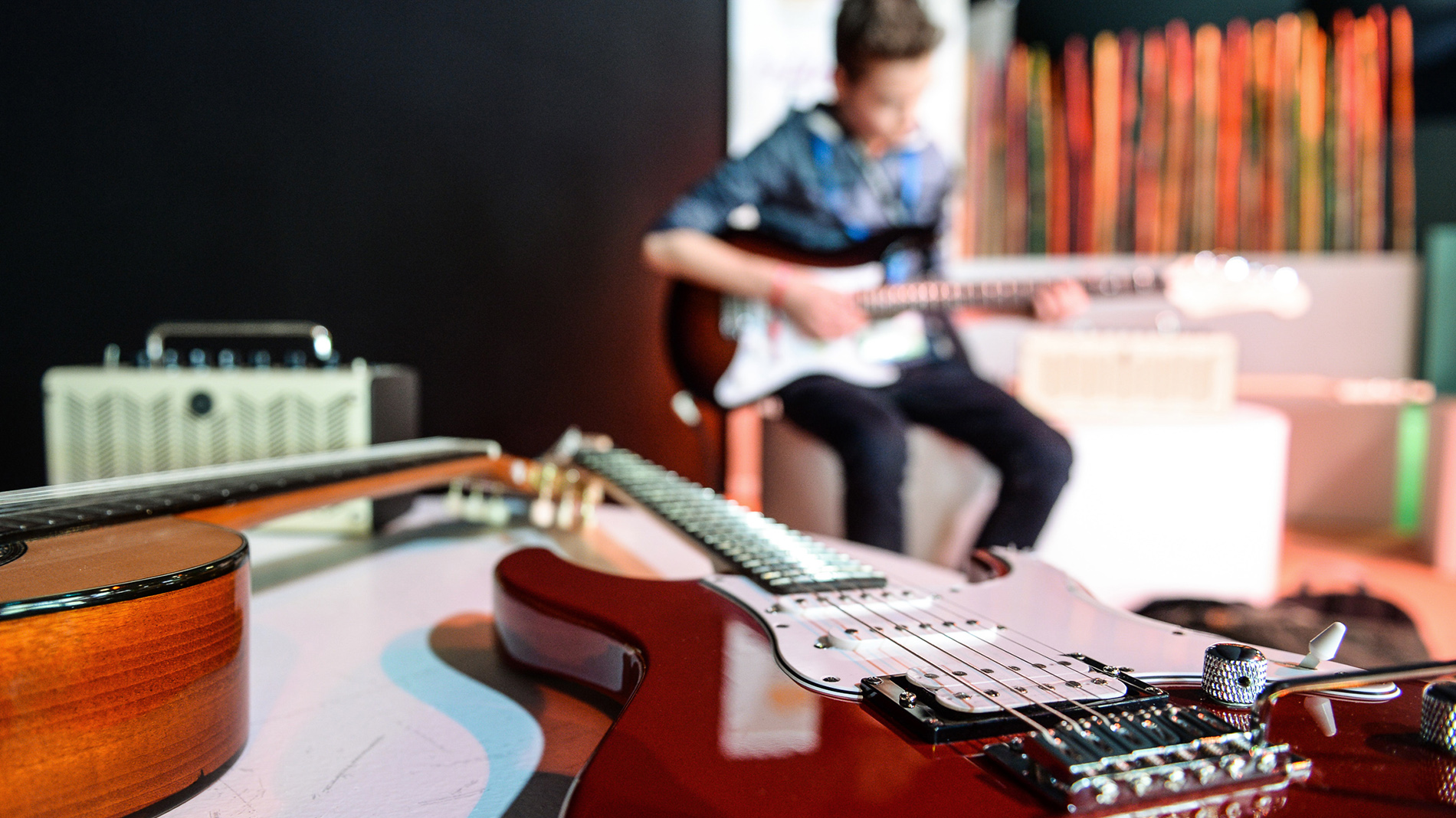 Discover Music at Musikmesse: boy is playing the electric guitar