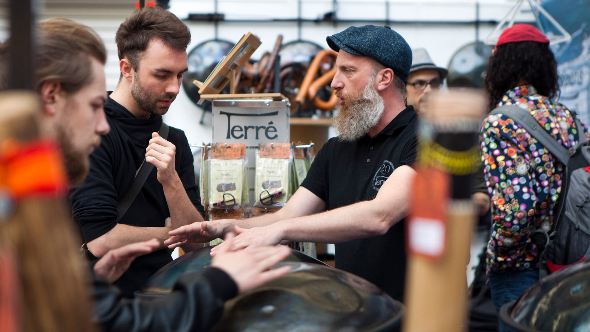 Visitors play Handpan at the Musikmesse