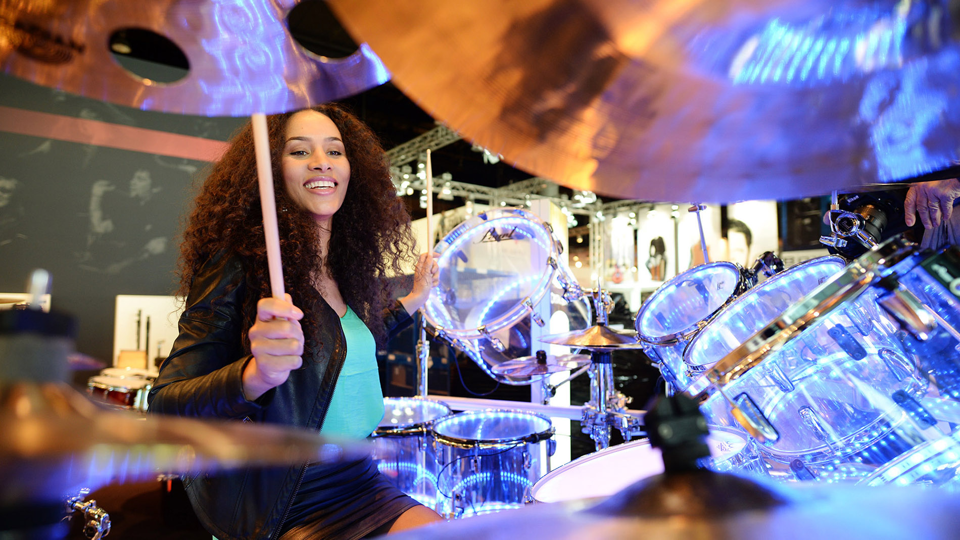Woman plays drums