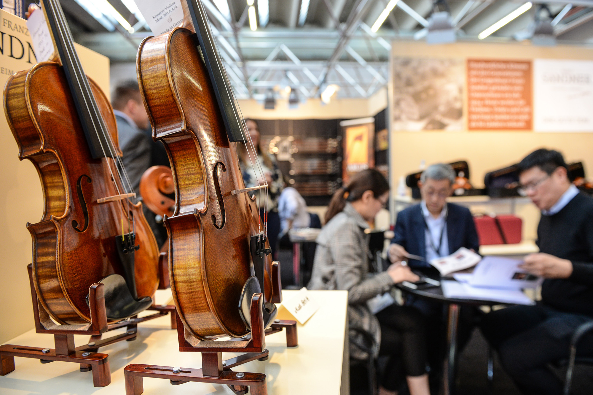 Violins at a booth at the Musikmesse