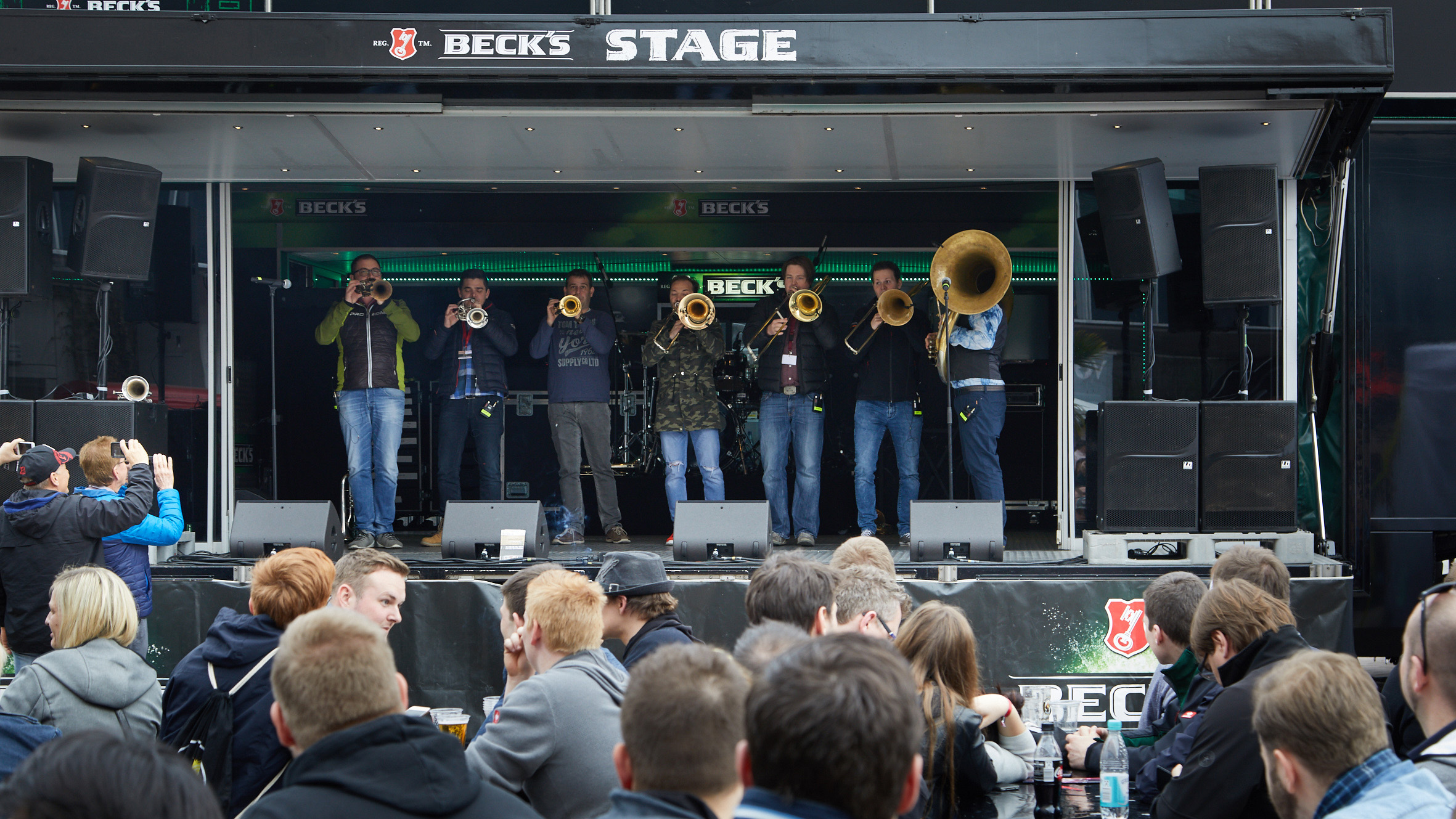 A band plays wind instruments on the Becks stage of the Musikmesse